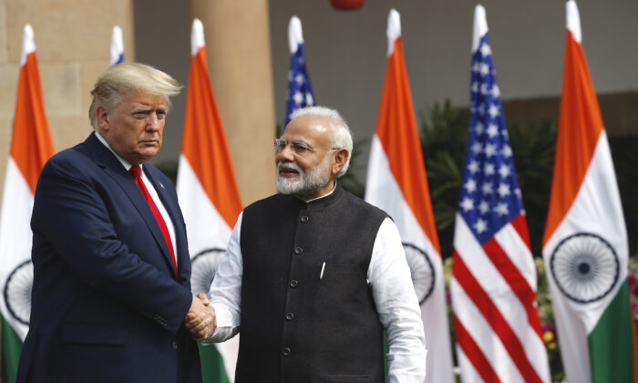 President Trump and Indian Prime Minister Narendra Modi shake hands before their meeting at Hyderabad House in New Delhi, India, on Feb. 25, 2020. (AP Photo/Alex Brandon)