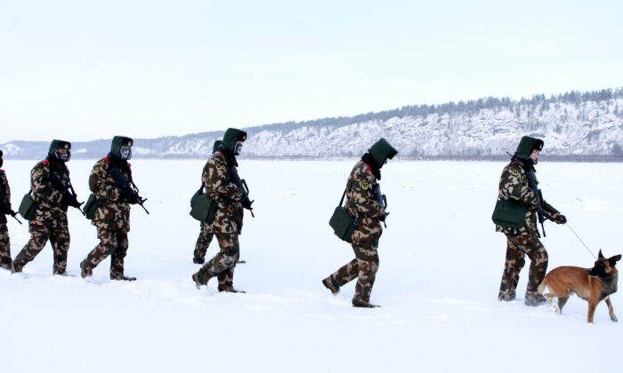 Chinese paramilitary police border guards train in the snow at Mohe County in China's northeast Heilongjiang Province, on the border with Russia, on Dec. 12, 2016. Mohe is the northernmost point in China, with a sub-arctic climate where border guards operate in temperatures as low as -36 degrees Celcius. (STR/AFP via Getty Images)