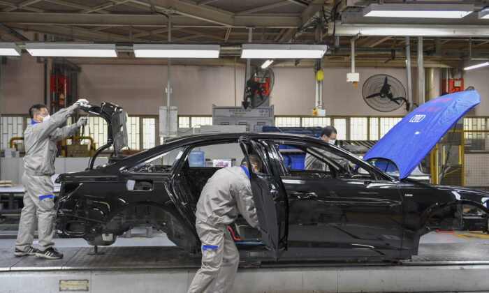 Workers assemble Audi A6 L cars at a workshop of FAW-Volkswagen Automobile Co., Ltd. in Changchun, northeast China's Jilin Province on Feb. 17, 2020. (Zhang Nan/Xinhua via AP)