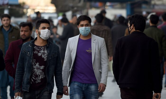 Men wearing protectives facemasks walk at the Shahr-i-Naw area in Kabul, Afghanistan, on Feb. 5, 2020. (Wakil Kohsar/AFP via Getty Images)