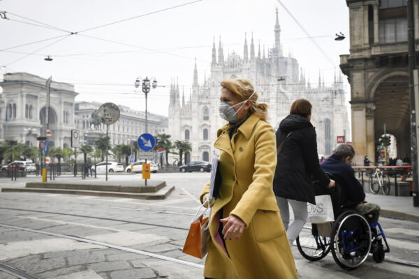 A woman wears a sanitary mask in Italy