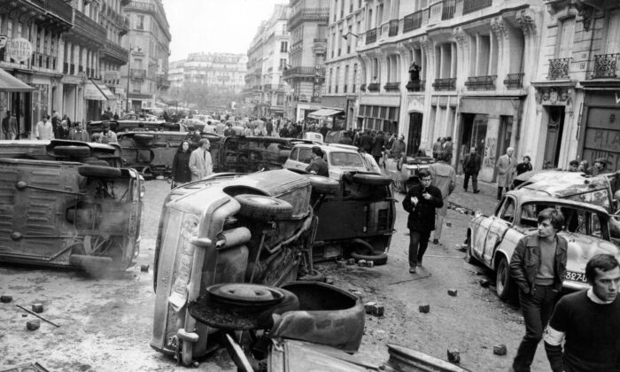 Overturned cars on Gay-Lussac Street in Paris on the morning of May 11, 1968, after violent fights between students and police the night before.  (AFP via Getty Images)