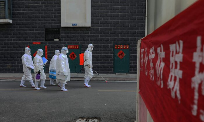 Laboratory technicians making their way during an epidemiological investigation in Linyi in China's eastern Shandong province on Feb. 10, 2020. (STR/AFP via Getty Images)
