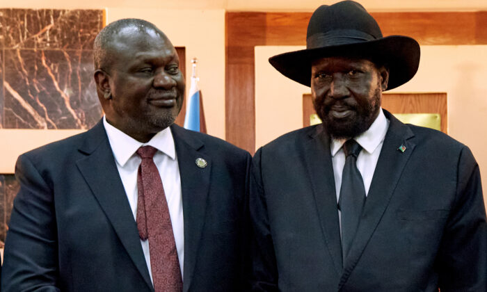 South Sudanese President Salva Kiir (R) shakes hands with First Vice President Riek Machar as he ttends his swearing-in ceremony at the State House in Juba, South Sudan, on Feb. 22, 2020. (Alex McBride/AFP via Getty Images)