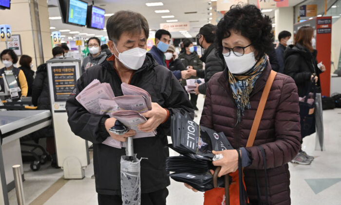 People buy face masks at a retail store in Daegu, South Korea, on Feb. 25, 2020. (Jung Yeon-je/AFP via Getty Images)