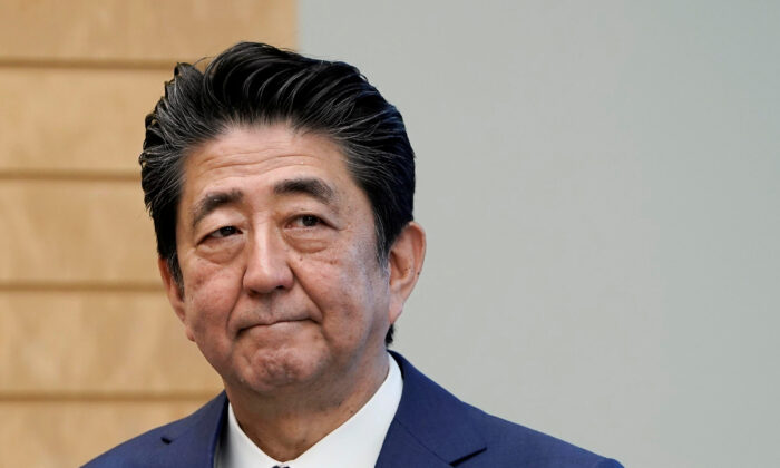 Japanese Prime Minister Shinzo Abe listens to IAEA Director General Rafael Grossi at the prime minister's official residence in Tokyo, Japan, on Feb. 25, 2020. (Kimimasa Mayama/Pool via Reuters)