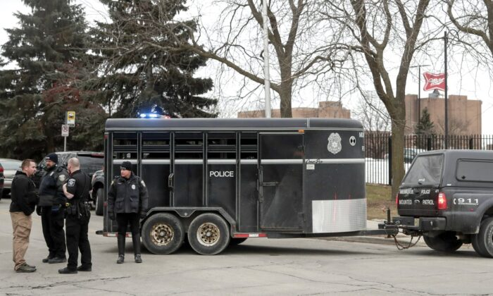 Police work outside the Molson Coors Brewing Co. campus in Milwaukee on Feb. 26, 2020, after reports of a possible shooting. (Morry Gash/AP Photo)