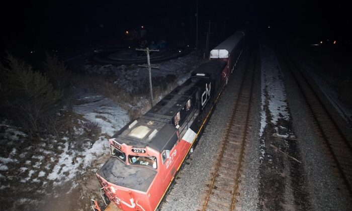 A CN train travels through Tyendinaga, near Belleville, Ont., on Feb. 24, 2020, after police removed the blockade in support of Wet'suwet'en Nation hereditary chiefs attempting to halt construction of a natural gas pipeline on their traditional territories in northern B.C. (Lars Hagberg/The Canadian Press)