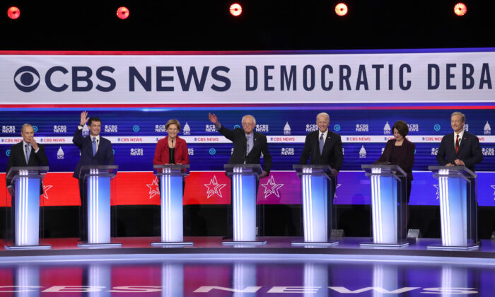 Democratic presidential candidates (L-R) former New York City Mayor Mike Bloomberg, former South Bend, Indiana Mayor Pete Buttigieg, Sen. Elizabeth Warren (D-Mass.), Sen. Bernie Sanders (I-Vt.), former Vice President Joe Biden, Sen. Amy Klobuchar (D-Minn.), and Tom Steyer participate in the Democratic presidential primary debate at the Charleston Gaillard Center in Charleston, S.C., on Feb. 25, 2020. (Win McNamee/Getty Images)