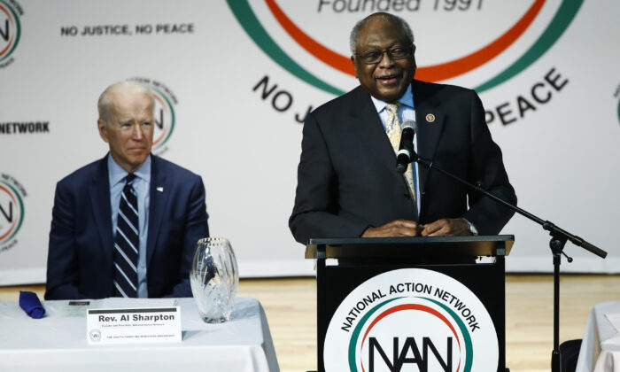 Democratic presidential candidate former Vice President Joe Biden listens to Rep. James Clyburn (D-S.C.) speak at the National Action Network South Carolina Ministers' Breakfast in North Charleston, S.C., on Feb. 26, 2020. (Matt Rourke/AP Photo)