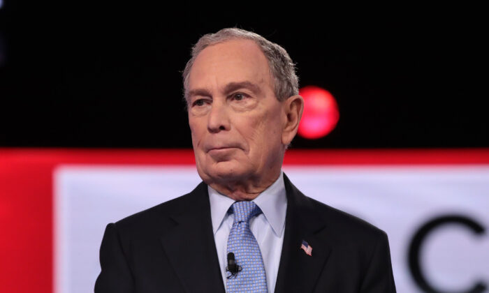 Former New York City Mayor Mike Bloomberg arrives on stage for the Democratic presidential primary debate at the Charleston Gaillard Center in Charleston, South Carolina on Feb. 25, 2020. (Scott Olson/Getty Images)