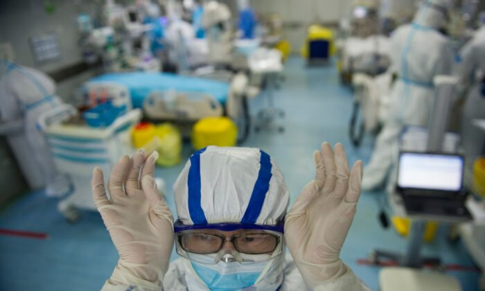 A nurse adjusts his goggles in an intensive care unit treating COVID-19 patients at a hospital in Wuhan, China, on Feb. 22, 2020. (STR/AFP via Getty Images)