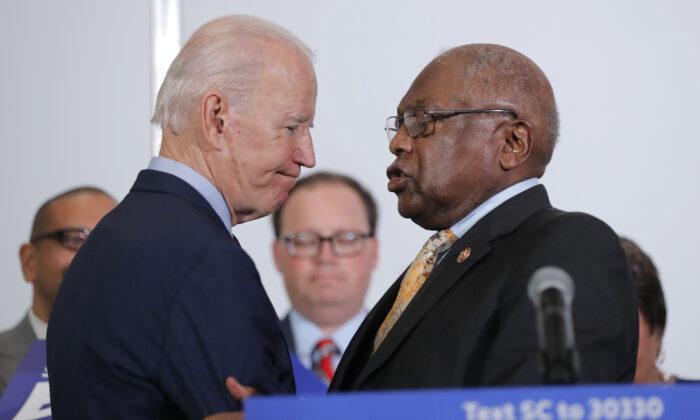 House Majority Whip James Clyburn (D-S.C.) greets Democratic presidential candidate and former Vice President Joe Biden at the National Action Network South Carolina Ministers' Breakfast in North Charleston, S.C. on Feb. 26, 2020. (Gerald Herbert/AP Photo)