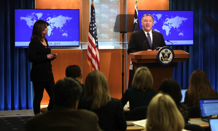 U.S. Secretary of State Mike Pompeo speaks as State Department spokesperson Morgan Ortagus listens during a news briefing at the State Department in Washington on Feb. 25, 2020. (Alex Wong/Getty Images)