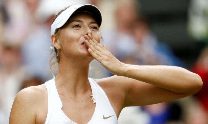 Maria Sharapova of Russia celebrates after defeating Sabine Lisicki of Germany in their semi-final match at the Wimbledon tennis championships in London on June 30, 2011. (Eddie Keogh/Reuters File Photo)