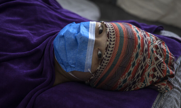 A patient is lying in a private obstetric hospital in Wuhan, China, on Feb. 24, 2020. (Getty Images)