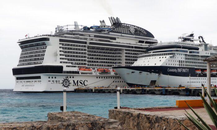 MSC Meraviglia cruise ship (L) is seen in Cozumel, Mexico, on Feb. 27, 2020. (Jose Castillo/AFP via Getty Images)