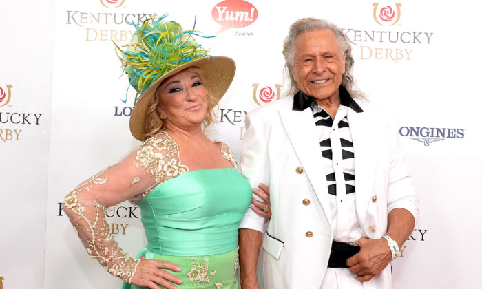 Musician Tanya Tucker (L) and executive Peter Nygard attend the 142nd Kentucky Derby at Churchill Downs in Louisville, Ky on May 7, 2016.  (Gustavo Caballero/Getty Images for Churchill Downs)