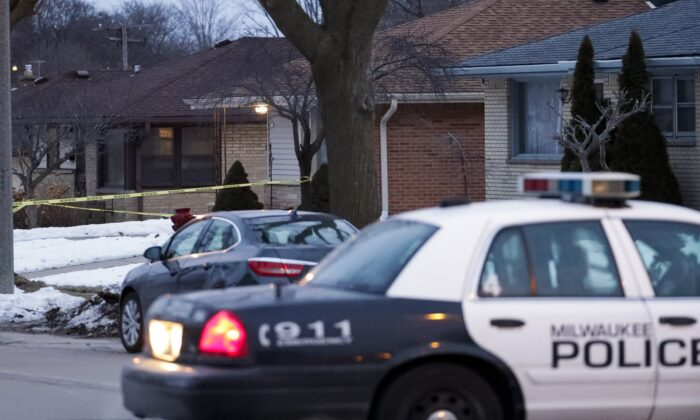 Police are seen outside of a house near Potomac and Courtland after a shooting at Molson Coors on Feb. 26, 2020, in Milwaukee. (Morry Gash/AP)