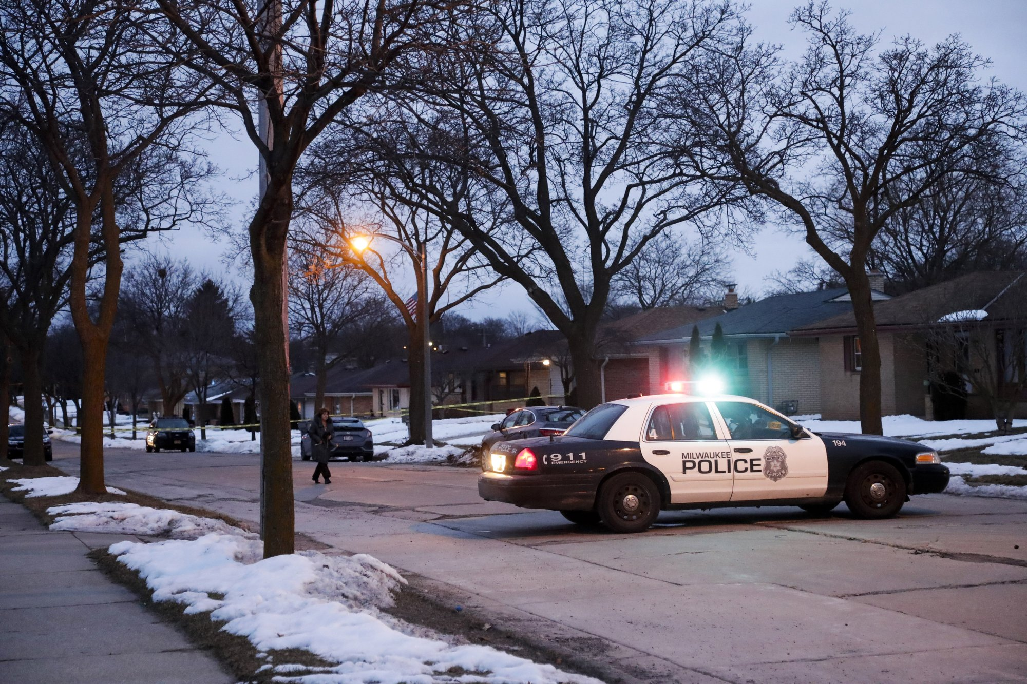Police are seen outside of a house