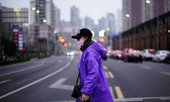 A woman wearing a face mask is seen on a street in downtown Shanghai, China, on Feb. 26, 2020. (Aly Song/Reuters)