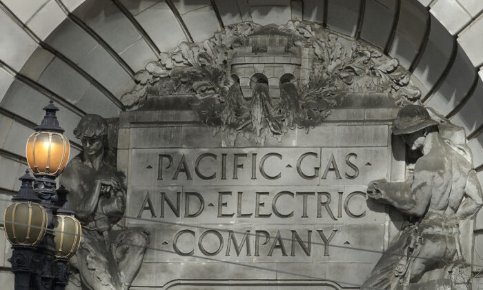 A Pacific Gas & Electric sign is shown outside of a PG&E building in San Francisco, Calif., on Oct. 10, 2019. (Jeff Chiu/File via AP)