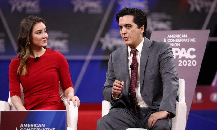 Joshua Philipp, senior reporter at The Epoch Times, and Morgan Zegers of Young Americans Against Socialism speak at the CPAC convention in National Harbor, Md., on Feb. 28, 2020. (Samira Bouaou/The Epoch Times).