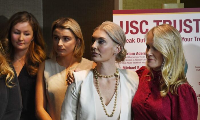 A group of current and former University of Southern California students who were allegedly sexually assaulted by gynecologist Dr. George Tyndall attend a press conference in Los Angeles, Calif. on Oct. 18, 2018. (Mark Ralston/AFP via Getty Images)