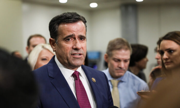 Rep. John Ratcliffe (R-Texas) speaks to media while other impeachment defense team advisors look on, at the Capitol in Washington on Jan. 27, 2020. (Charlotte Cuthbertson/The Epoch Times)