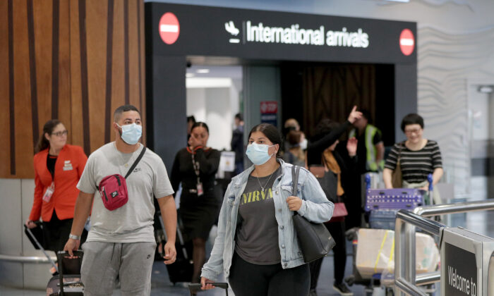 Passengers arriving on flights wear protective masks at the international airport in Auckland, New Zealand, on Jan. 29, 2020. (Dave Rowland/Getty Images)