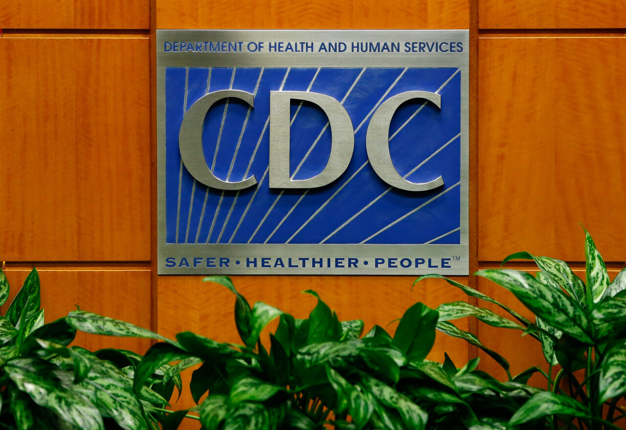 A podium with the logo for the CDC