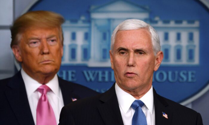 President Donald Trump looks on as Vice President Mike Pence speaks during a news conference on the COVID-19 outbreak at the White House on Feb. 26, 2020. (Andrew Caballero-Reynolds/AFP via Getty Images)