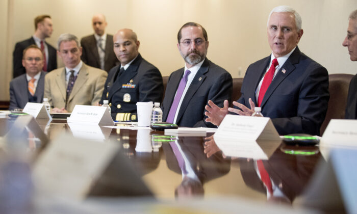 Vice President Mike Pence, accompanied by left, President Donald Trump's acting Chief of Staff Mick Mulvaney, acting Deputy Secretary of Homeland Security Ken Cuccinelli, Surgeon General Jerome Adams, Health and Human Services Secretary Alex Azar and National Institute for Allergy and Infectious Diseases Director Dr. Anthony Fauci, speaks at a coronavirus task force meeting at the Department of Health and Human Services, in Washington, on, Feb. 27, 2020. (AP Photo/Andrew Harnik)