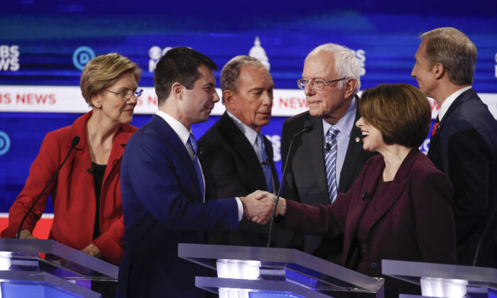 From left: Democratic presidential candidates, Sen. Elizabeth Warren (D-Mass.), former South Bend Mayor Pete Buttigieg, former New York City Mayor Mike Bloomberg, Sen. Bernie Sanders (I-Vt.), Sen. Amy Klobuchar (D-Minn.), and businessman Tom Steyer, greet on another on stage at the end of the Democratic presidential primary debate at the Gaillard Center in Charleston, S.C., on Feb. 25, 2020. (AP Photo/Patrick Semansky)