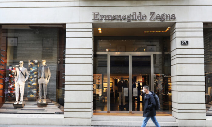 A man wears a protective mask as he walks in front of the Ermenegildo Zegna store in Via Montenapoleone, the most important road of the fashion district in the city center where all the luxury brand are located on February 29, 2020 in Milan, Italy.  Italy registered a surge in coronavirus cases in the last few days with infections remaining centered on outbreaks in two northern regions, Lombardy and Veneto. (Marco Di Lauro/Getty Images)