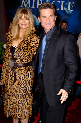 woman in leopardskin coat, man in dark blue suit