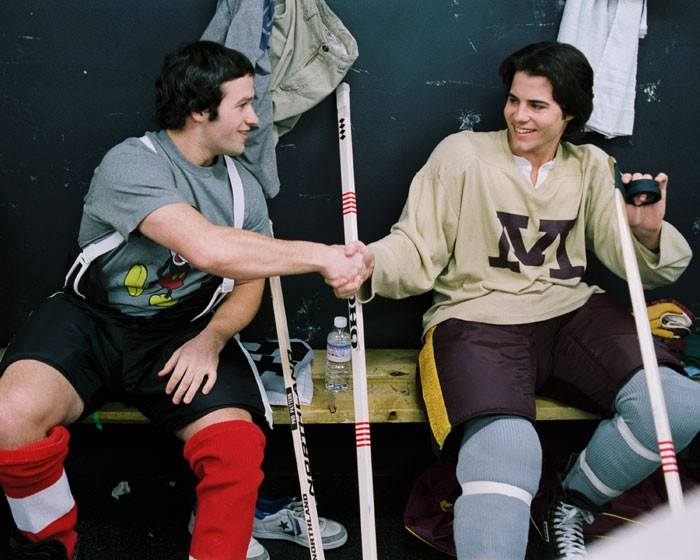 two hockey players shake hands