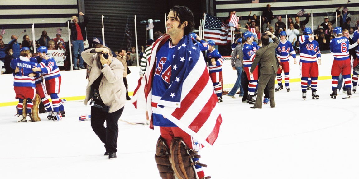hockey player draped in American flag