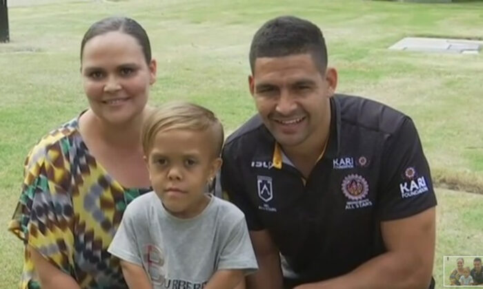 In this photo taken from video provided by Australian Broadcasting Corporation, Quaden Bayles, center, his mother, Yarraka Bayles, and Cody Walker, a professional rugby league player, pose together Friday, Feb. 21, 2020, in Gold Coast, Australia (Australian Broadcasting Corporation/Associated Press)