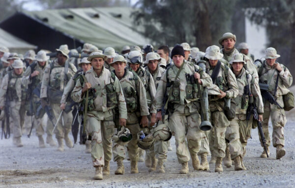 American Marines with full battle gear prepare to leave the U.S. military compound