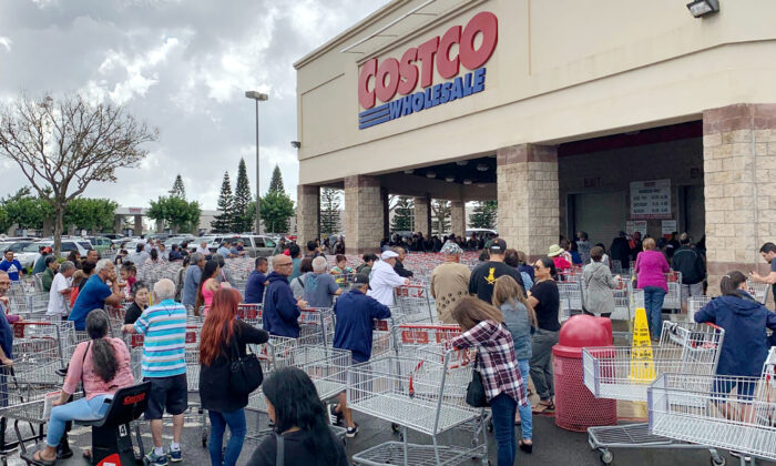 Shoppers line up outside a Costco to buy supplies amid the COVID-19 outbreak in Honolulu, Hawaii, on Feb. 28, 2020. (Duane Tanouye via Reuters)