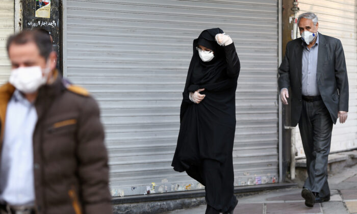 Iranian people wear protective masks to prevent contracting a coronavirus, in Tehran, Iran Feb. 29, 2020. (West Asia News Agency/Nazanin Tabatabaee via Reuters)