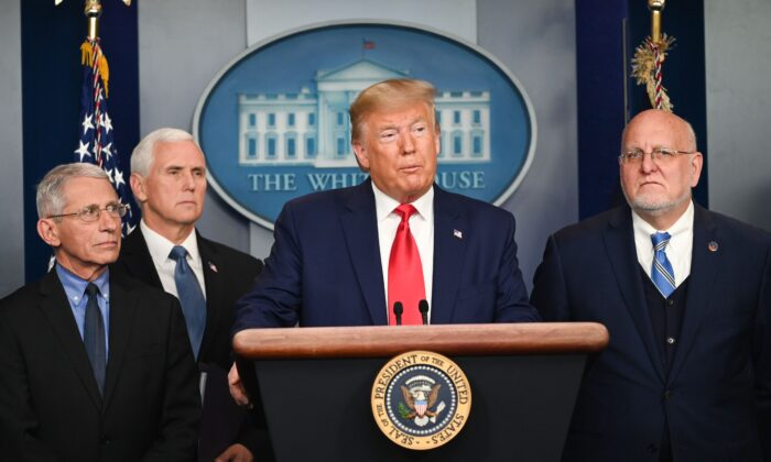 President Donald Trump speaks as Director of the National Institute of Allergy and Infectious Diseases at the National Institutes of Health as Anthony Fauci (L), Vice President Mike Pence (2L), and Director of the Centers for Disease Control and Prevention Robert Redfield (R) look on during a press conference on the COVID-19 coronavirus outbreak at the White House in Washington on Feb. 29, 2020. (Roberto Schmidt/AFP)