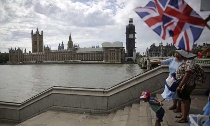 People stand on the steps to Westminster Bridge opposite the Houses of Parliament in London on Sept. 3, 2019. The weekend Britain left the EU, Conservative MP Erin O'Toole called for the implementation of CANZUK, a campaign for a new alliance between Canada, the U.K., Australia, and New Zealand. (AP Photo/Matt Dunham)