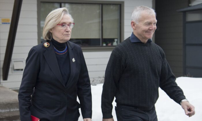 Federal Minister of Crown-Indigenous Relations Carolyn Bennett and B.C. Indigenous Relations Minister Scott Fraser arrive to address the media in Smithers, B.C., on Feb. 28, 2020. (The Canadian Press/Jonathan Hayward)