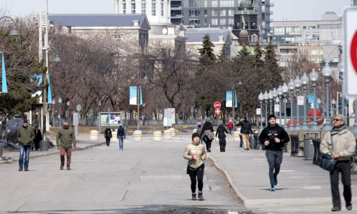 People are shown out walking in the Old Port of Montreal on March 25, 2020, as COVID-19 cases rise in Canada and around the world. (The Canadian Press/Graham Hughes)