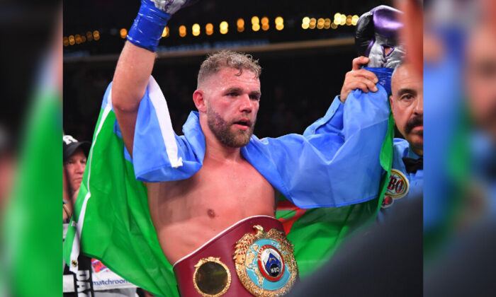 Referee Ray Corona in the ring with Billy Joe Saunders after he defeated Marceleo Coceres in their WBO World Super-Middleweight Championship fight at Staples Center in Los Angeles, Calif., on Nov. 9, 2019. (Jayne Kamin-Oncea/Getty Images)