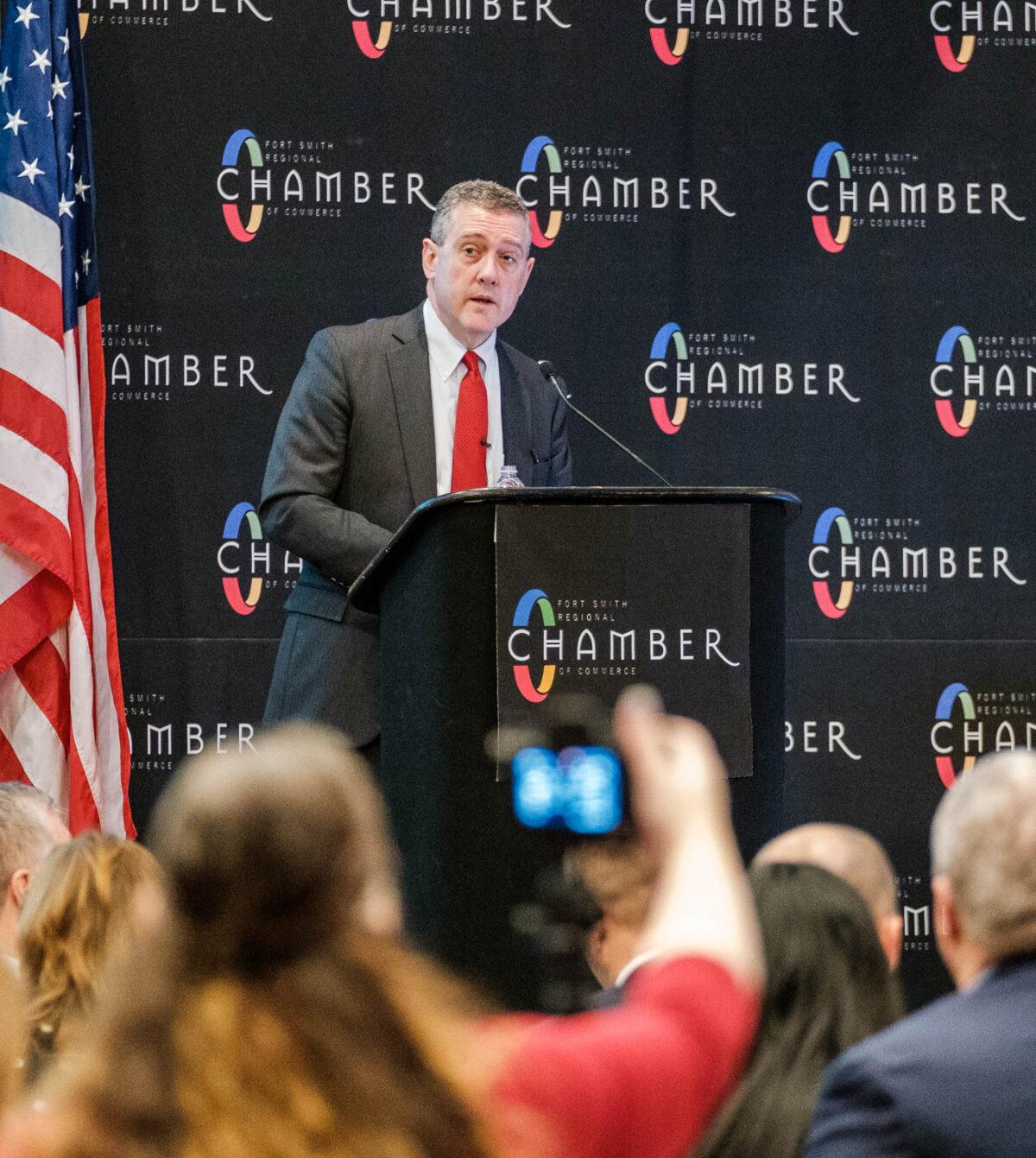 Fed president speaks on podium