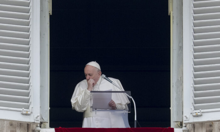 Pope Francis coughs during the Angelus noon prayer he recited from the window of his studio overlooking St. Peter's Square, at the Vatican, on March 1, 2020. (Andrew Medichini/AP Photo)