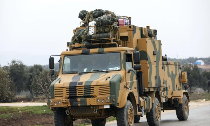 A Turkish military convoy drive in the east of Idlib, Syria, on Feb. 28, 2020. (AP Photo)